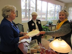 Glenda Clendinin, (L to R) Director of Moore County Board of Elections, officially receives 109 challenges from Dee Park and Carol Wheeldon.